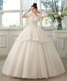 Combination of Elegance and Luxury.Sheer V-Neck,Pearls Short Sleeves,Lace And Tulle Fabric,All creates this beautiful wedding dress,floor length suits beach garden wedding perfectly.