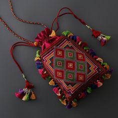 Suf embroidery is a type of counted thread weaving practised these days around the Kutch district of Gujarat and beyond. Embroidery Bags, Embroidery Fashion, Hand Embroidery Designs, Beaded Embroidery, Kutch Work Designs, Handmade Fabric Bags, Potli Bags, Diy Handbag, Patchwork Bags