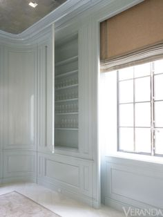 paneled dining room storage with window covering solved as well