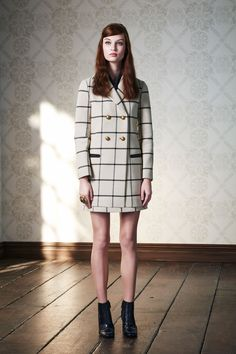 Tory Burch; while apart, we love the coat and the skirt...together, it leaves something to be desired. From a distance it could easily look as though you aren't wearing any bottoms! So either lengthen the skirt, shorten the coat, or don't wear together. Just our humble opinion.