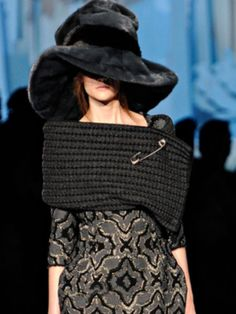 I do love the giant safety pin on this designer crochet shawl by Marc Jacobs