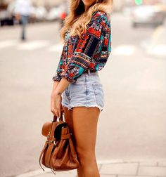 high-wasted, light washed shorts && a cute long sleeved && silk, patterned blouse.
