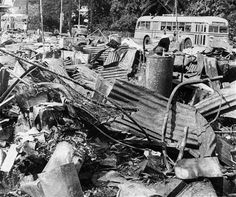 A mass of twisted metal wreckage lay along a Honolulu street after the city had been attacked by Japanese planes Dec. 7, 1941. (AP Photo)