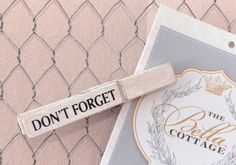 """Keep your notes tidy with this charming memo frame! Wire mesh comes stretched inside a French inspired frame. Painted cream and distressed for a vintage style look. Each memo board includes three clothes-pins painted white. Each reads, """"Leave a Note,"""" """"Note to Self,"""" and """"Don't Forget."""" Just pin your note to the mesh to keep it secure and handy! Would look lovely hanging in the kitchen, office or by the phone!  <BR><BR> • Wood, Chicken Wire<BR> • Cream<BR> • Ready to Hang<BR> • 19 1/2 X..."""
