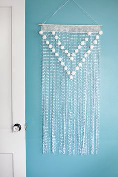 Pom Pom Wall Hanging - make something like this for the wall above the basement stairs?