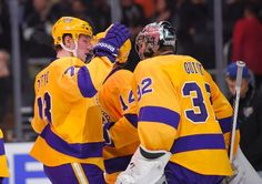 Los Angeles Kings center Tyler Toffoli, left, and goalie Jonathan Quick congratulate each other after an NHL hockey game against the Calgary Flames, Thursday, Feb. 12, 2015, in Los Angeles. The Kings won 5-3. (AP Photo/Mark J. Terrill)
