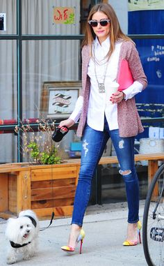 Olivia Palermo glams up to take her pooch for a walk in NYC!