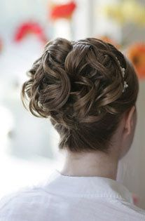 french braid from the bottom with curls coming out the top.