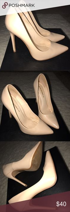 Nude patent leather pumps Only worn a couple of times nude patent leather pumps...they have no scuffs or scratches. Looks great with jeans, dresses or skirts! Love these shoes! They are a must have in every girls closet ❤️ shoe republica Shoes Heels