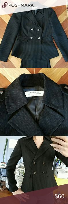"""Tahari Black Pantsuit Tahari Black with white dot pinstriped pant suit. Jacket can be worn as outerwear if desired. Very cute silver button detail on front and shoulders. Peplum style jacket with faux pockets. This listing includes pants and jacket. No wear, in perfect condition. 29"""" inseam on the pants. I'd love to keep it, but unfortunately I'm not a petite size. Tahari Jackets & Coats Blazers"""