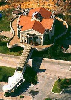 WOW! The person I pinned this from said it was a house.  Someone else commented and said it was the  Hardrock Cafe in FL.