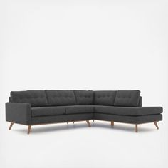 Without veering from the Mid-century modern design playbook, this structured sofa captures the clean lines, tall tapered legs and iconic button detail that charmed an entire era. Its linear form will easily blend with other styles for a seamless mix.