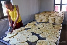 Drepung Loseling monks making Tibetan flatbread. ©yowangdu.com