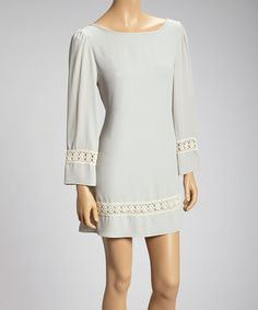 With a belt at the waist, leggings, tall boots, and jewelry. Silver Crocheted Trim Dress by Basically Me on #zulily