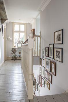 Old photos line the staircase #interiors #WTinteriors