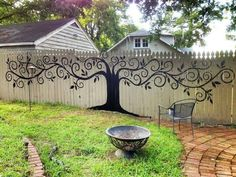 Painted mural on wooden fence - nice idea.
