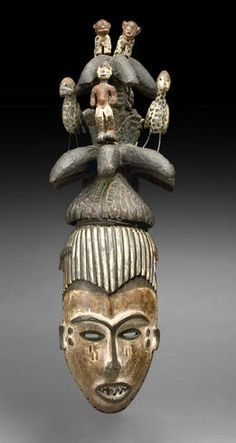 Africa | Maiden Spirit Mask ~ aghogho mmwo ~ from the Igbo culture, Nigeria | Partial helmet form, pierced around the edges for attachment, with a complex superstructure