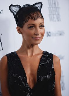 Nicole Richie in sequins and lace. Only she can get away with lace cat's ears.