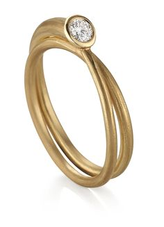 One of my favs.  A simple 18KY gold wire is wrapped to give the appearance of 2 overlapping rings. #goldring #artisanjewelry