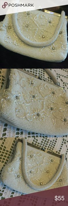 Dainty beaded vintage purse Antique beaded purse with not a single bead or rhinestone missing that I can tell. Inside has one serious bad mark but the rest of the satin lining is in very good condition. Vintage  Bags Mini Bags