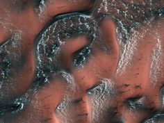 Dry ice lies across a series of dunes like a dusting of powdered sugar in this image from the Mars Reconnaissance Orbiter 8/24/17