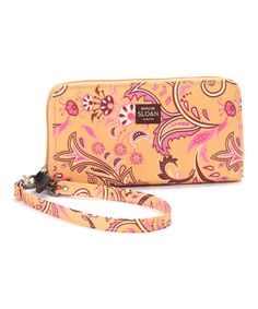 Secure gear in style with this smart wristlet. Its petite silhouette provides the perfect place to tuck a few essential items, and its removable strap means it can be used as a clutch, cosmetic bag or shoulder bag!