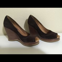 Brown suede Michael Kors wedge heels shoes size 8 In used condition but mostly you can see the wear inside the shoe, there are some toe / feet prints. Suede is in mostly great condition. Shoes are a chocolate brown and a size 8. Michael Kors Shoes Wedges