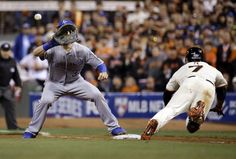 Kansas City Royals first baseman Eric Hosmer takes the throw to first as San Francisco Giants Gregor Blanco dives to first base on a ground out during the eighth inning of Game 3 of baseball's World Series Friday, Oct. 24, 2014, in San Francisco. (AP Photo/Matt Slocum)