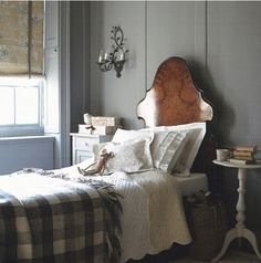 Gray accented by stunning headboard and buffalo check.