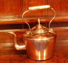A large Mid 19th. Century seamed Copper Kettle with a Brass handle and Acorn finial on the lid. Circa. 1850.
