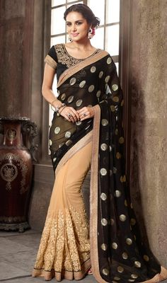 Become an enchanting secret dolled up in this black and beige color net viscose half n half sari. Beautified with lace, stones and resham work.  #satinsaree #fancysarees #fashionablesari
