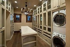 walk-in closet with laundry | Laundry Room / Walk-in Closet, just add mirrors and it's perfect! love the glass front cabinets