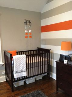 Baby nursery decor...Grey and Orange Nursery by katemaedesigns I like baskets under crib for extra storage
