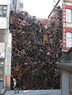 Colombian-born sculptor Doris Salcedo's work addresses the question of memory and forgetting. For the 8th International Istanbul Biennial, her installation featured 1,600 wooden chairs stacked precariously in the space between two buildings.