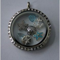 Beach Themed Locket like Origami Owl!  Only $24.99 for the locket and 7 charms!!  Can't wait for Summer and going to the Beach!!