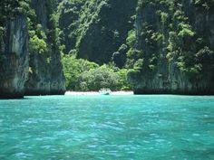 Phi Phi Islands in Thailand are known for theirs beautiful cliffs, caves, clear water, white sandy beaches and rich marine life