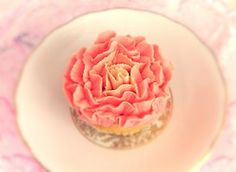 Rose petal cupcake design with soft pink and cream accents  www.designerscupcakes.com