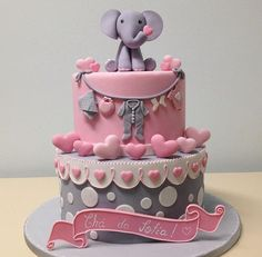 Pink and grey baby girl cake