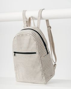 An everyday canvas backpack. **** 10.5 in. W x 15.5 in. H x 6 in. D.Interior sleeve holds a 13 inch MacBook.Front zip pocket.Adjustable straps. 100% 16 oz. recy