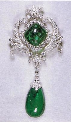 The Queen`s Scroll Cambridge Emerald & diamond brooch. Originally made for Princess Mary Adelaide, Duchess of Teck, then later used by her daughter Queen Mary who left it to the Queen in 1953.