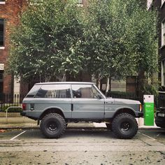 Range Rover EV? Lol. 80's Range Rover monster truck parked at the EV charging station in Dublin #rangerover