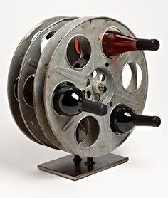 Film Reel Wine Rack http://hative.com/man-cave-stuff-ideas/