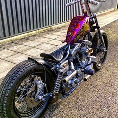 Shovelhead swingarm custom with small sportster tank and curved tuck and roll solo seat
