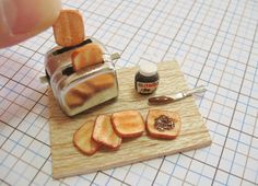 I made this limited edition nutella toaster set in scale. Miniature Nutella and Toaster Set Mini Kitchen, Miniature Kitchen, Miniature Crafts, Miniature Food, Miniature Dolls, Barbie Food, Doll Food, Tiny Food, Fake Food