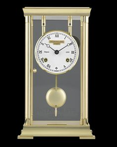 Patek Philippe Mantel Display Clock~ This classic pendulum display clock was crafted by the celebrated watchmaking firm Patek Philippe of Geneva. It operates thanks to its complicated 8-day mechanical movement, which, combined with its pendulum, runs the timepiece with true precision. The time is told on a white enamel dial with black Roman numerals, while bells chime at the quarter, half and full hours. ~M.S. Rau Antique Clocks, Patek Philippe, Roman Numerals, White Enamel, Geneva, Quality Time, Display, Antiques, Classic