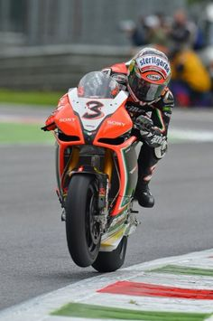 Monza, ITA - Max Biaggi brings up the front of his factory Aprilia RSV4. #Superbike