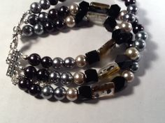 Hey, I found this really awesome Etsy listing at https://www.etsy.com/listing/191375217/black-and-gray-multistrand-bracelet