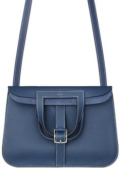 The Hermes Halzan Bag. In a minute we will tell you how 'cool' this beauty is, but let us start by sharing that it's from the latest Fall Winter 2014 Collection, which has just been released in sto… Hermes Halzan, Hermes Handbags, Handbags On Sale, Designer Handbags, Balenciaga Handbags, Designer Bags, Luxury Handbags, Round Bag, Crossbody Bag