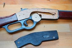This is as requested a DIY on, how to make a wooden toy Winchester rifle with a functioning lever action. NOTE: The lever is designed a bit different, than the real... Homemade Weapons, Homemade Toys, Wooden Diy, Wooden Signs, Rubber Band Gun, Winchester Rifle, Lever Action, Wooden Projects, Picture On Wood