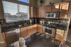 Traditional Kitchen with Black Galaxy Granite Countertop, Stonemark Granite, Raised panel, Inset cabinets, Slate Tile